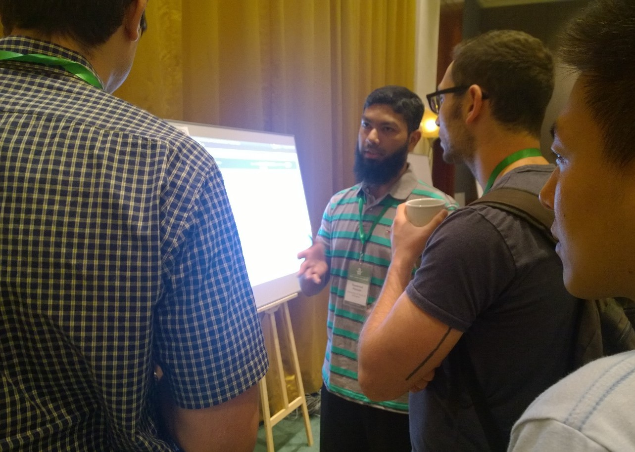 Naffi explaining FactWatcher demo to VLDB14 attendees in Hangzhou (Sept. 2014)